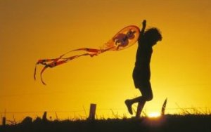 870436Child-Flying-a-Kite-at-Sunset-1-1